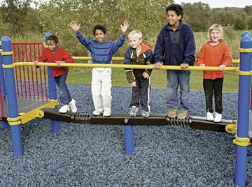 Children play on balance bar at playground
